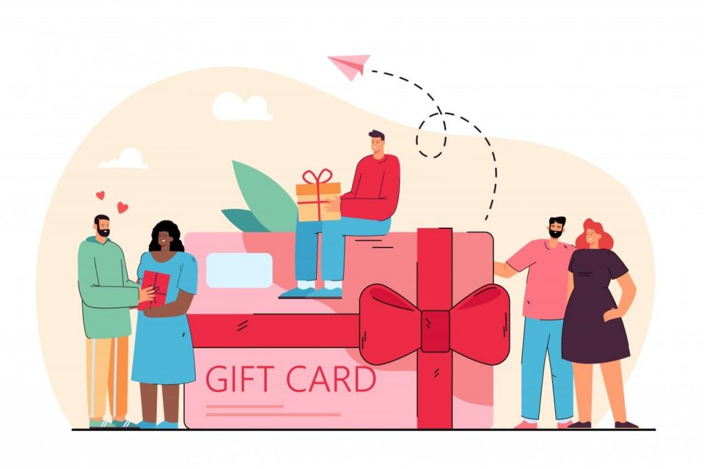 Tiny people near giant gift card voucher from store